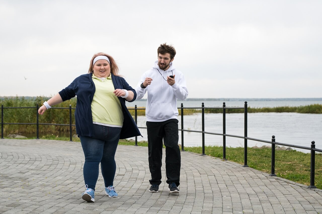 obese woman trying to lose weight by walking